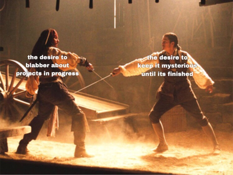 A Pirates of the Caribbean screenshot with Will and Jack sparring, representing the conflicting desires to blabber about projects in progress vs. keep them mysterious until they're finished