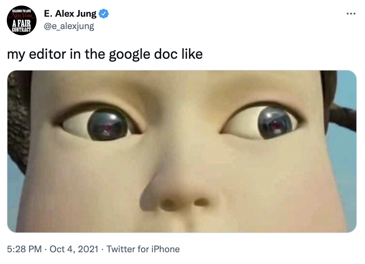 """A screenshot of a tweet. There is an image of the robot girl from Squid Game, her large eyes looking right, captioned """"my editor in the google doc like."""""""